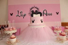 Minnie Mouse dessert table - love the skirt around the cake