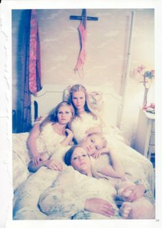 The Virgin Suicides: A tragically beautiful tale of 4 young girls (who follow the example of their youngest sister) that become trapped in there own home and finally end up killing themselves.
