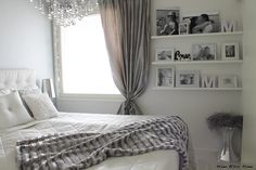 Love the white bedroom with shelves for pretty pictures