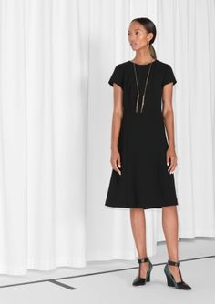 &OTHER STORIES  Elegant a-line dress, featuring short breezy sleeves and a luxurious, gold-coloured, back zip.