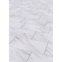 TrafficMASTER 12 in. x 24 in. Peel and Stick Carrara Marble Vinyl Tile-SS1212… seen in the bathroom of Migonis Home.  http://migonishome.porch.com/2016/08/full-bathroom-progress/