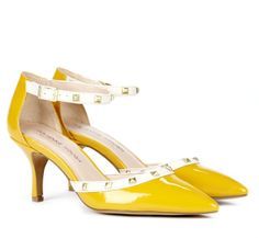 Pointed toe mid heel pump with adjustable ankle strap and stud detail. #mustard #dijon