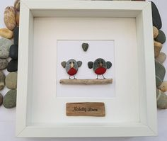A beautiful and unique handmade beach pebble picture - two Christmas robbins family standing on driftwood. This picture is a lovely Christmas decoration and would make a perfect gift. The picture is made using pebbles, driftwood, fabric, wood and jute twine. All materials are carefully placed and fixed with high strength glue onto grey card. There are 7 different designs of this picture, buyer can choose in the drop down menu. See images of signs. 1. Nadolig Llawen stamped with black ink on…