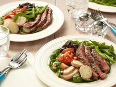 This filling Grilled Steak Salad Nicoise tops baby spinach with green beans, olives, tomatoes, red potatoes and grillled steak.
