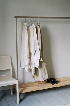 A clothes rail by Dean Edmonds made from powder-coated steel and pine.