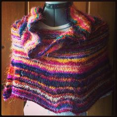 Knitting pattern for Cowl Neck Poncho - Denae's prize-winning design uses sport-weight Recycled Silk Yarn. The page is a little confusing but it looks like they used to offer the kit and now offer the pattern for $1.99. affiliate link