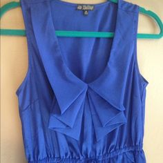 Blue Hi-Low Dress Lined skirt with pockets.  Drawstring waist is decorative only. I believe it is polyester, has a nice feel and lays well, but there is no tag. Only worn once for photos. BeBop Dresses High Low