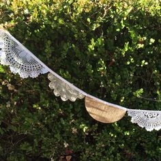 Our crocheted doily and burlap banners add just the right touch of romance to your special occasion