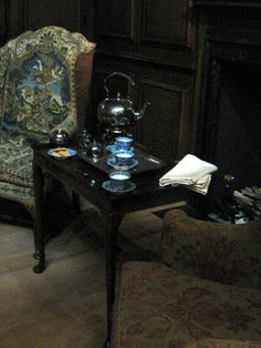 An English Dressing Room, c. 1710-1730 at the Royal Ontario Museum, Toronto - This photo shows a detail of the tea table and accoutrements in the dressing room, placed between two chairs in front of the fireplace.