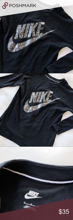 NIKE Oversized Black Crew Neck Sweater Medium Nike | Medium | Pullover sweater | Oversized | Black | Gray/Silver logo on front | Crew neck | Pink/orange spot on the back of sleeve hem (pictured) Nike Sweaters Crew & Scoop Necks