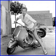 Esther Williams riding Vespa in Rome, 1960