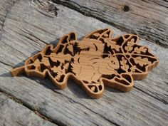 This beautiful carved oak leaf is inspired by the New Forest & rare red squirrels. Sculpture by wildwoodartist.