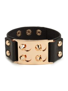 We named this tough-chic beauty for St. Marks Place in New York City. Why? Because with its black leather, gold hardware and spikes, it carries all the rock-and-roll glamour of the East Village.