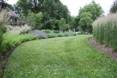 A minimalist garden comprised of herbaceous plants in an attractive composition embraces the romance of the space.