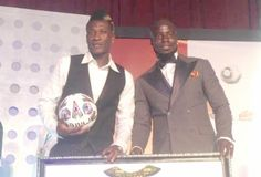 Asamoah Gyan (left)  poses with Stephen Appiah