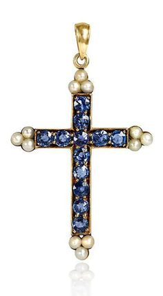 An antique pearl and sapphire cross, in 14k.  	      	  Circa:  	  1900
