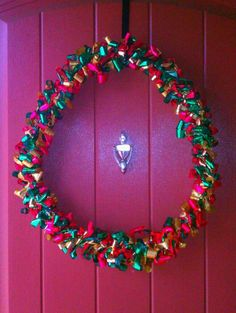 Christmas Wreath Made From Foam Pipe Wrap & Lots Of Curling Ribbon :)