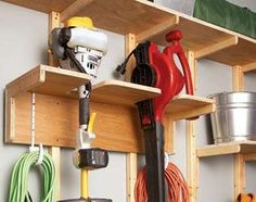 Weed trimmers and leaf blowers can slide around if you prop them in a corner, and fall off the wall if you try to hang them from a hook. Solve the problem with this custom storage rack, which uses 3/4-in. plywood for the brackets, top and back. Cut two 8-in. x 11-in. brackets to support the top and back of the rack. customize the dimensions to fit your yard tools. To determine the best shape for your slots, measure the diameter of your tools and cut basic basic slots in the top of the rack.