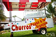 This is a fun destination wedding reception food idea, a Mexican Churros Cart. A churro is a Latin American snack consisting of a strip of fried dough, very similar to funnel cake.
