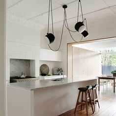 Exposed cable pendants. The Aim Multi-Light Pendant.  https://cheerhuzz.com/collections/ceiling-lights/products/aim-multi-light-pendant-for-flos-lighting-pl364-3?variant=11441388228