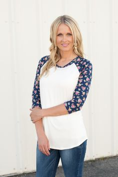 Ivory front with navy floral print sleeves.
