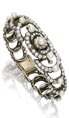 A late 19th century pearl and diamond bracelet, circa 1890 The openwork crescent-shaped links set with rose and old brilliant-cut diamonds, highlighted by a line of baroque and button-shaped pearls, diamonds approximately 13.00 carats total, pearls remain untested, inner diameter 5.0cm