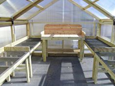 Optional plant tables and potting bench with pressure treated wood and cedar in a A-Frame Greenhouse from Backyard Unlimited Greenhouse Tables, Outdoor Greenhouse, Small Greenhouse, Greenhouse Plans, Greenhouse Gardening, Greenhouse Shelves, Greenhouse Wedding, Greenhouse Staging, Homemade Greenhouse