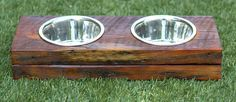 Reclaimed wood dog bowl stand. This is a double with two 6 bowls. The reclaimed wood is salvaged from homes in Atlanta, GA and is approximately 70 - 100+ years old. Stained with a clear outdoor polyurethane for protection from the elements.