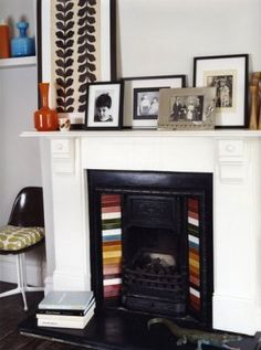 *orla kiely's fireplace... gorgeous. of course!
