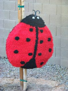Ladybug Pinata Little Lady Pink Ladybug by PartyHousesupplies, $59.99. I like this one better. But I don't think we'll do a Pinata after all. . . it would probably make April cry.