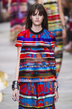 The@Roberto_Cavallishow was a visual feast of skilled techniques and textures, we love this pleated set in fluro brights. #MFW #SS15
