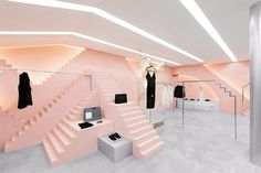 Novelty is a fashion clothing boutique launched in 2013 characterized by the selection of high couture garments and accessories from New York City.   In our treatment for the space, pink tones and height fluctuations along geometrical shapes compose a new style for the brand's interior design.