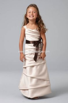Awh, so cute and she looks like a mini bridesmaid! This is made by Watters!