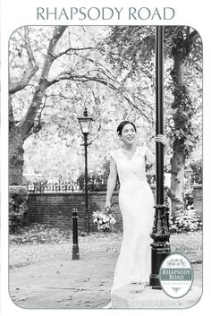 Love this shot of the bride leaning against a lamp post at the registry office in Peckham, London. I love the way her wedding dress falls on the steps and the way she holds her flowers. (flowers by Jam Jar Flowers - https://www.facebook.com/JamJarFlowers )
