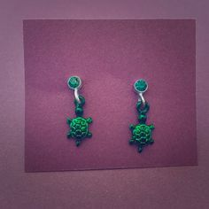 Tiny Turtle Earrings Tiny green turtles hang from a green stud. Both backs included. Jewelry Earrings