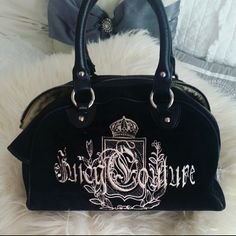 """Juicy Couture Handbag Great condition. Black isn't faded at all. Zipper pocket inside along with two side compartments. Some scuff marks as shown in last picture. Roomy and opens wide to be able to see everything in bag.  MEASUREMENTS:  L 12"""" H 8.5"""" W 6"""" Juicy Couture Bags"""