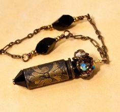 Bullet jewelry Jet Black Etched Bullet Necklace by Dazzlez. $39.00, via Etsy.
