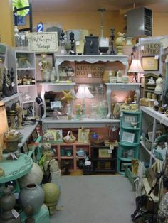 """http://TGtbT.com tells resale shopkeepers: Having at least 1 corner of your consignment or thrift shop as """"treasure trove"""" is wise merchandising. Here, stacked tables & shelves are a framework for a menagerie of goods... doesn't it look tempting?"""