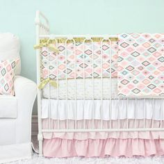This collection features a modern golden arrow crib sheet and a coordinating gradient blush ruffle crib skirt. This set is perfect for any baby girl's nursery!