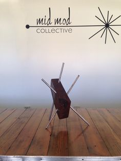 Custom Metal & wood abstract sculpture. Available now at Mid Mod Collective. Email midmodcollective@gmail.com for more info. SOLD!