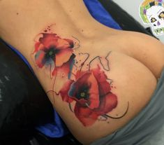 Watercolor style poppy tattoos.
