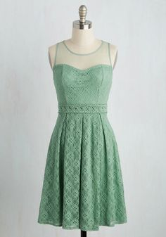Floating down the bustling avenue, you admire the sugary sights of patisseries while adorned in this delicate, sage dress.