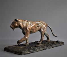 by Adrian Flanagan titled: 'Lioness (Bronze Pacing Hunting Tracking sculpture)'. Animal Sculptures, Lion Sculpture, Animal Garden Ornaments, Bronze Sculpture, Figurative Art, Lions, Saatchi Art, Pottery, Statues