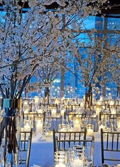 You can never have too many candles! Hurricane candles in varying heights add a soft glow to an all white reception. Wedding Decorations, Lighting Design, Candles, Winter Weddings