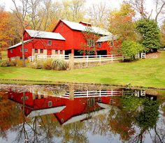 Reflection of a Red House. This bright, fall day produced a nice reflection of the attractive red house. This was near Morristown, New Jersey.