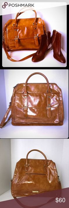 """Steve Madden Cognac Satchel Steve Madden Cognac Satchel/ 100% authentic/ size: LRG/ gold hardware/ no stains on inside or outside of the purse/ length: 15 1/2"""", height: 12 1/2"""", / small scuff on front bottom of the purse; can see in pictures listed) pockets in both front, back of the purse and zipper pocket inside of the purse: prefect for iPads and laptops plus room for personal items (very roomy) great condition! Steve Madden Bags Satchels"""