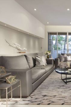 the DKOR Interiors design team came up with a home design concept filled with clean lines, a monochromatic colour palette, deeply textured materials, and contemporary furniture.