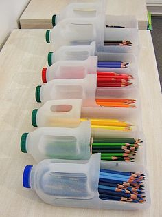 Recycled milk containers for storing markers, colored pencils, and other supplies.