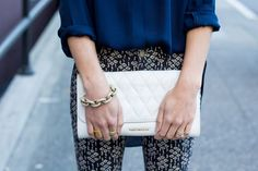 Our White Leather Quilted Harper Clutch is at its best next to @thefoxandshe while she is out and about in Seattle.