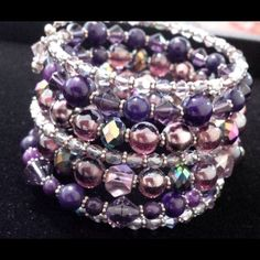 Purples, bracelet. Design & handmade by JJ. 7 rows of lavender and purples combined with crystals, glass pearls, purple glass, and silver plated beadings. Unique style one of a kind. Handmade and Designed by JJ. Josefina Jewelry Designs Jewelry Bracelets